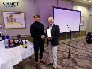 Paul Sansome with Graham Kingaby – Managing Director at NIVO Group – collecting his prize for the longest drive.